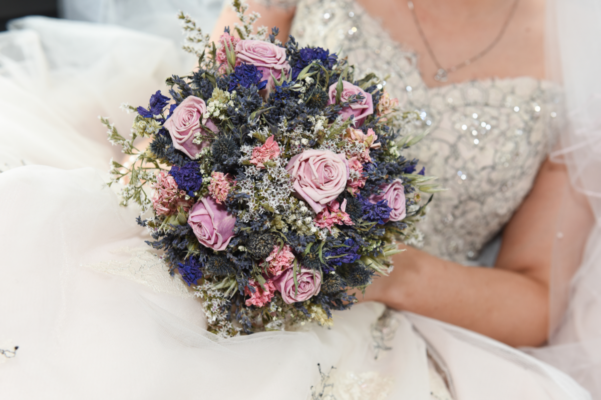 rustic bouquet with colourful lilac and green flowers on a glittery corset